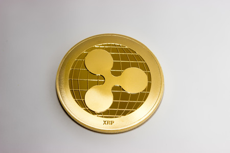 On a white background is gold coin of a digital crypto  currency - ripple xrp. The front side of the gold coin ripple. 版權商用圖片