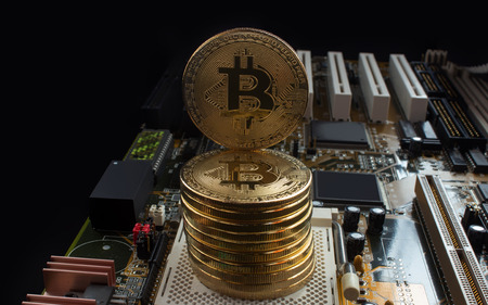 He and his motherboard have gold coins of a digital crypto currency - bitcoin.