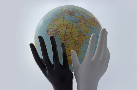 Symbol of peace and cooperation. Hands support globe on white background.