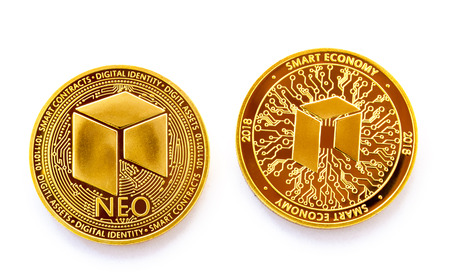 On a white background is isolated the front and back side of gold coin of a digital crypto  currency - neo.