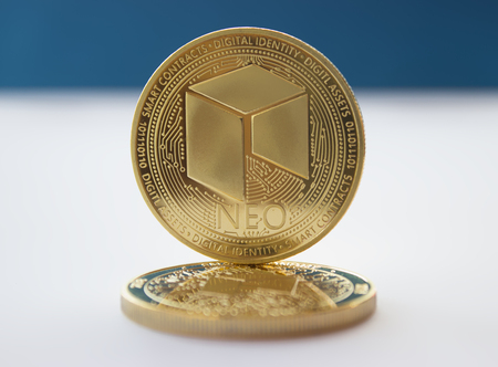 On a blue background are coins of a digital crypto  currencies - neo. In addition to the lying coin, there is standing neo.