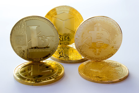 On a gray background are gold coins of a digital crypto  currencies - neo, bitcoin litecoin. In addition to the lying coins, there are standing neo bitcoin and litecoin.