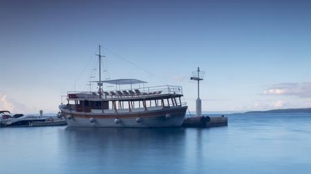Anchored cruise ship in the harbor of Brela in  Croatia Stock Photo