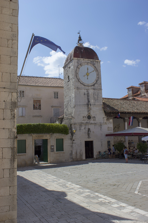 Clock Tower in Trogir with European flag