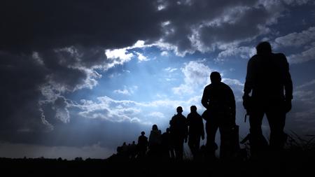 Sun rays illuminate people. Immigration of people.