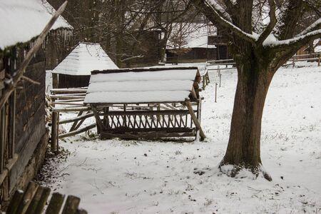 Feeder for animals in snowy landscape in roznov pod radhostem in czech republic