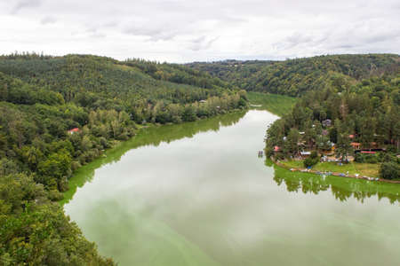 View from the Cornstejn castle on the water level in which the reflection of the trees