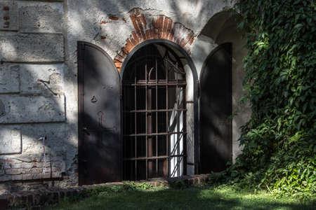Old barred window on the castle, Czech Republic, Europe