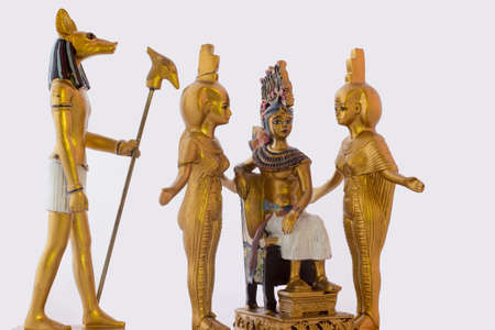 Still life with egyptian figures of anubis, pharaoh and the goddess nebtht and eset