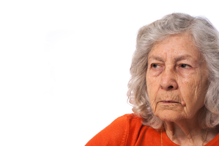 Mature woman in orange blouse Stock Photo