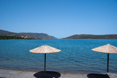 Beach Straw umbrella in Elounda, Crete, Greece