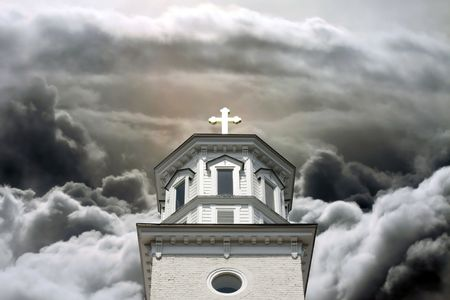 cloudscape: Church steeple with golden cross in a cloudscape