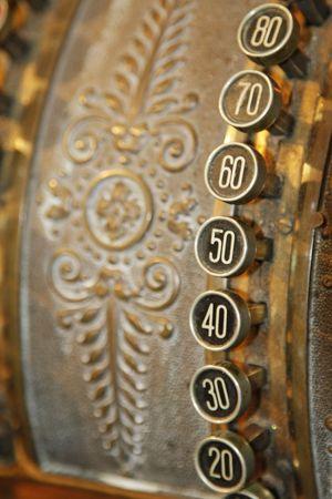 Buttons on an old brass cash register circa 1843
