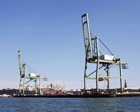 Gantry cranes for handling shipping containers.