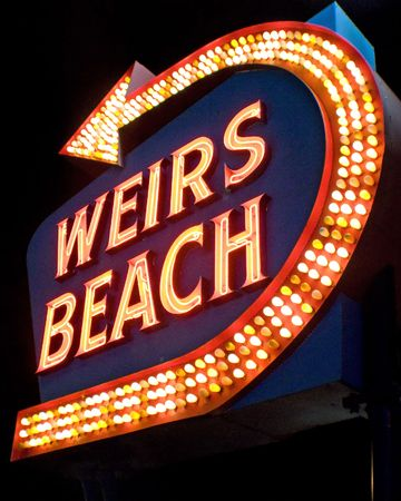 laconia: Weirs Beach NH sign lit at night Stock Photo
