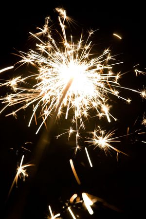 Sparkler illuminates the night with sowers of sparks
