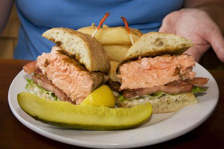 Yummy salmon sandwich lunch with a pickle Stock Photo