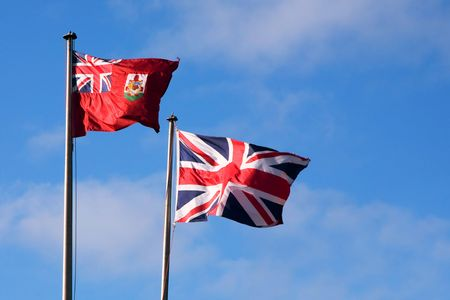 Bermuda and British flags flying on a bright day