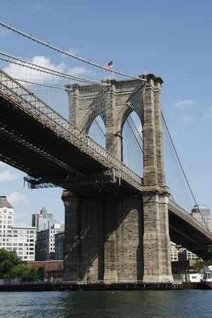 Brooklyn Bridge looking up from the East River New York City
