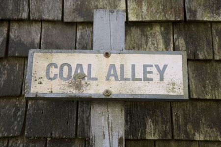 Old wood sign for Coal Alley Nantucket