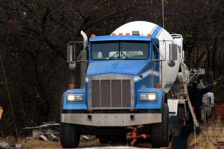 jobsite: Concrete truck pouring concrete on a jobsite