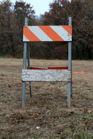 Orange and white safety construction barricade