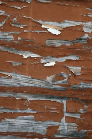 Old wood siding with paint peeling off