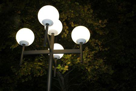 Five light street lamp illuminating the night