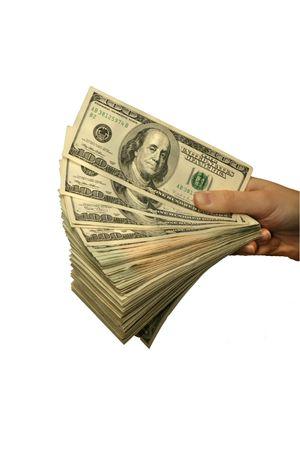 Ein Wad des amerikanischen Bargeldes, das überreicht wird. Standard-Bild - 2175682