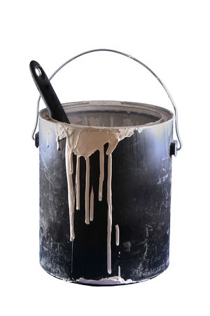 messy:  A close up of a black paint can with white paint dripping a paintbrush handle sticking out on a white background