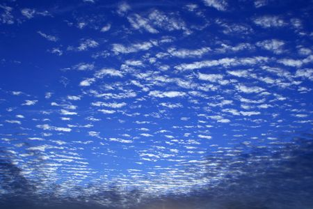 A bright blue sky with pretty white fluffy clouds...
