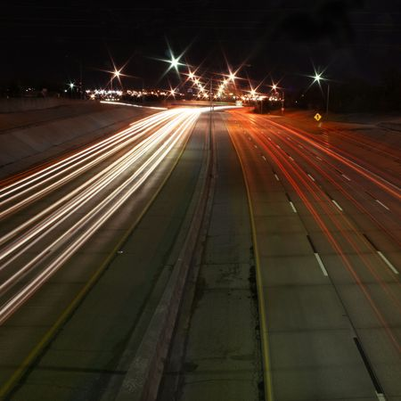 nightime: A prolonged time exposure of a highway at nightime Stock Photo