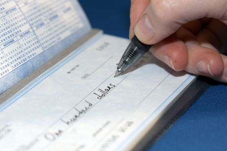 Closeup of a person writing a big check