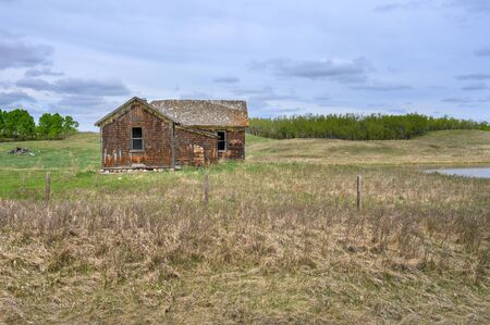 Old homestead house on the prairie near Big Valley, Alberta, Canada