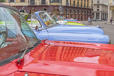 Havana, Cuba, April 09, 2019 – Vintage automobiles parked on the street near the Capital Building