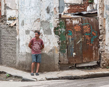 Havana, Cuba, April 09, 2019 - An man standing at a street intersection in Old Town Editorial
