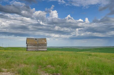 Granary on a prairie hilltop near the town of Chaplin, Saskatchewan, Canada