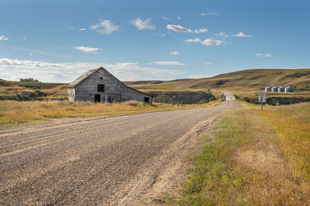 Abandoned barn on a country road at Sharples, Alberta, Canada