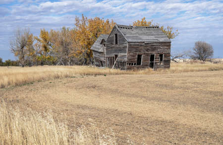 Abandoned farmhouse near the town of Foremost, Alberta, Canada
