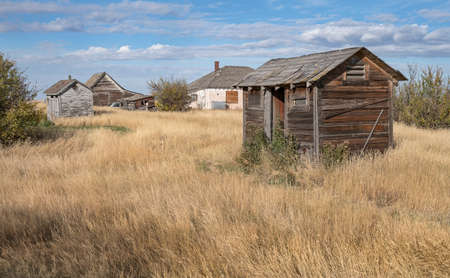 Old outhouses in the ghost town of Nemiskam, Alberta, Canada