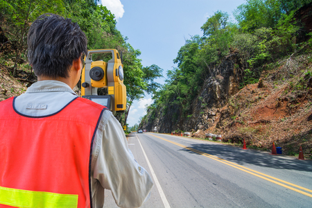 Surveying or land surveying is the technique, profession, and science of determining the terrestrial or three-dimensional position of points and the distances and angles between them Stok Fotoğraf - 87172758