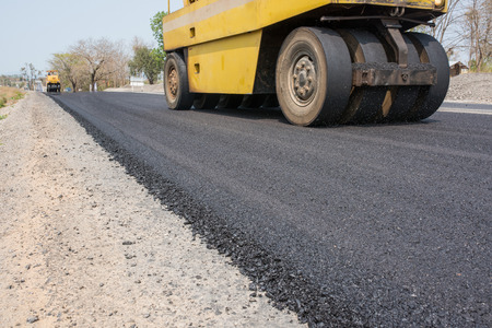 asphalt concrete on paver machine