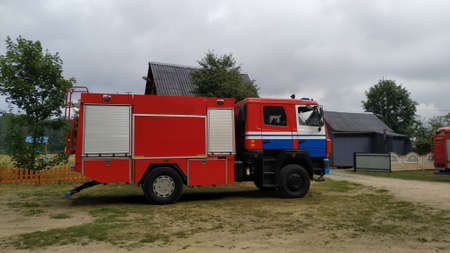red and white fire truck in the village.
