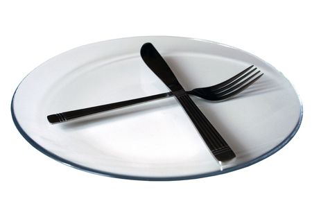 Plate with knife and fork on white background Stock Photo