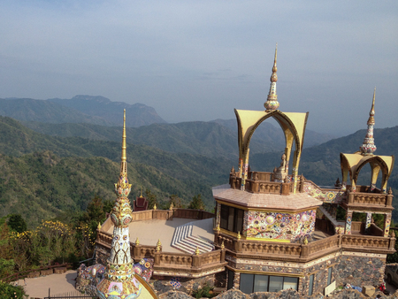 This is a famous place in Phetchabun, Thailand. This place name Wat Pha Sorn kaew. A wonderful mountain hill temple with colorful achitecture.