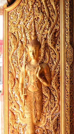 This is  a picture of a beaurifully decorated door in Buddha Temple in Thailand. Stock Photo