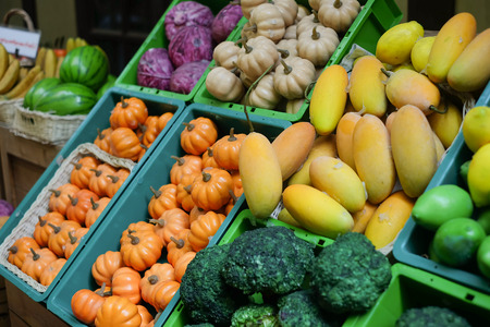 This is a picture of variety of fruits which are put in many containers for selling. Stock Photo