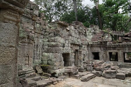 Preah Khan is a temple at Angkor, Cambodia, built in the 12th century. It is very old temple as we can see some tree grow upon the temple wall