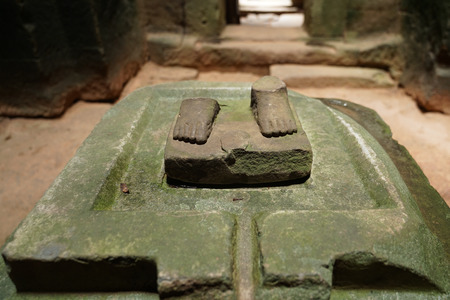 This is sculpture of buddha foots in Preah Khan temple at Angkor, Cambodia, built in the 12th century. Editorial