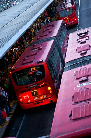 Crowded Transmilenio Buses Arrive at the Portal del Norte in Bogotá, Colombia